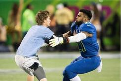 Watch Ezekiel Elliott Tackle A Fan During Pro Bowl