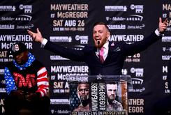 """Conor McGregor Really Wore A Custom """"F*ck You"""" Suit At Press Conference"""