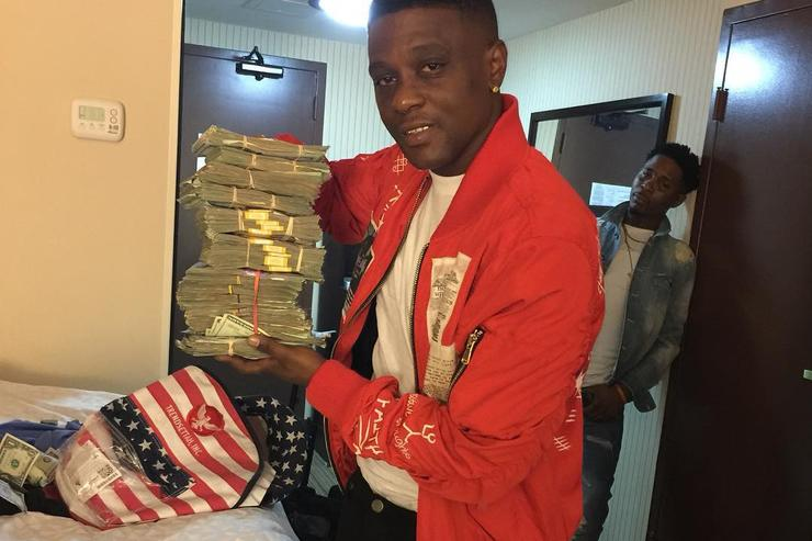 Boosie with a stack of cash