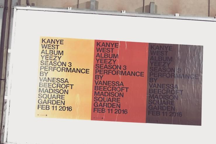 Kanye West and Kim Kardashian in front of a Yeezy season 3 billboard