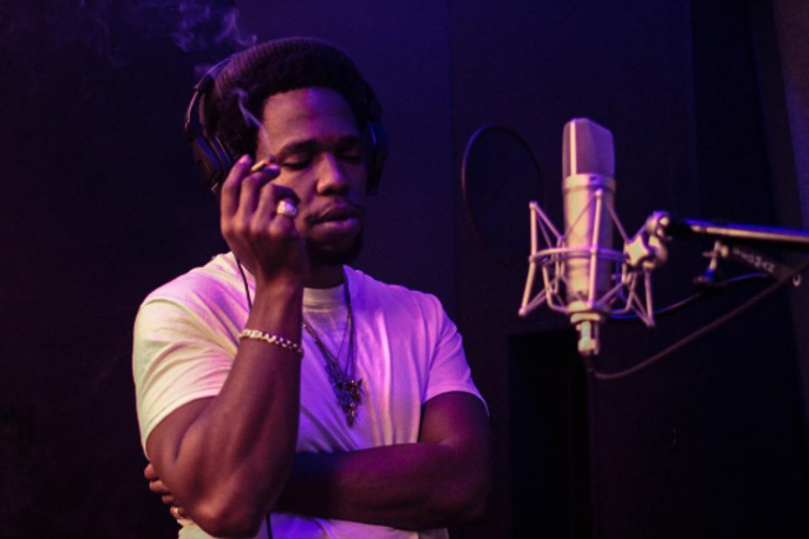 Curren$y dropping some bars in the booth.