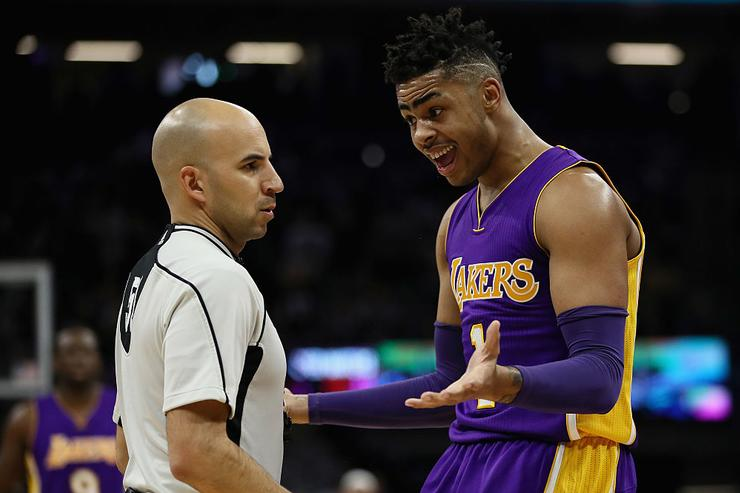 D'Angelo Russell #1 of the Los Angeles Lakers questions a call by referee Aaron Smith during their game against the Sacramento Kings at Golden 1 Center on December 12, 2016 in Sacramento, California.