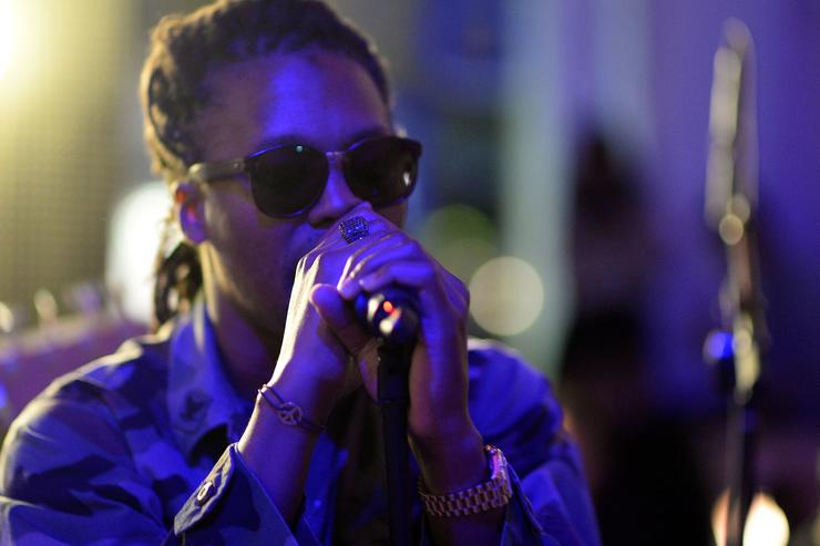 Lupe Fiasco performing at Born In Blue exhibition.