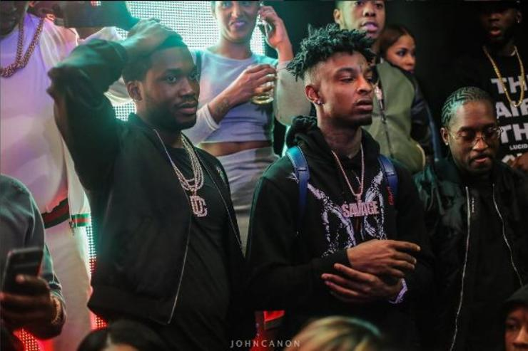 Meek Mill and 21 Savage attend an event together.