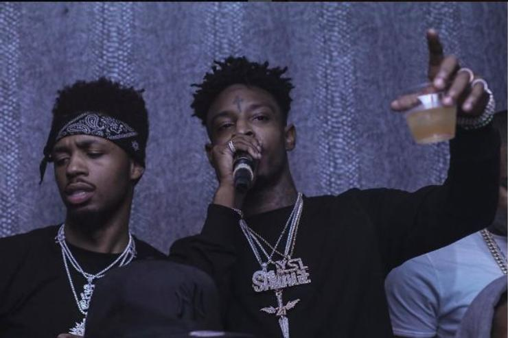 Metro Boomin and 21 Savage hanging out at an event.