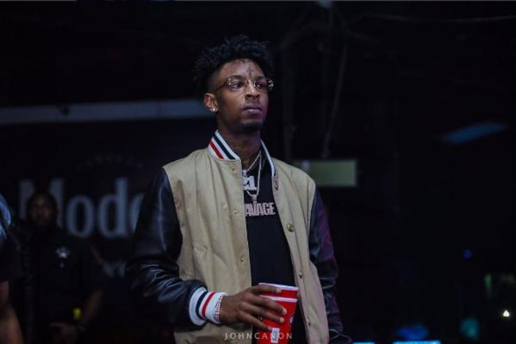 21 Savage holds a red cup.