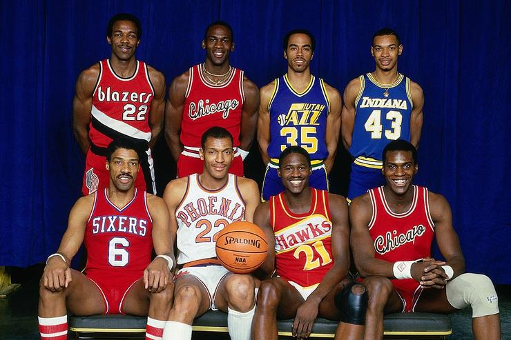 Front Row (L-R) Julius Erving, Larry Nance, Dominique Wilkins, Orlando Woolridge, Back Row (L-R) - Clyde Drexler, Michael Jordan, Darrell Griffith and Terrence Standsbury pose for a portrait prior to the 1985 Slam Dunk Contest on February 9, 1985 at Market Square Arena in Indianapolis, Indiana.