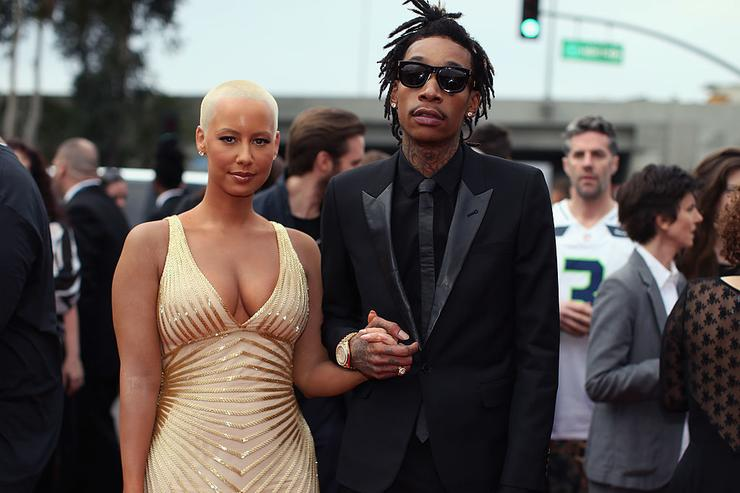 Wiz Khalifa (R) featured wearing Converse in support of the GRAMMY Foundation's GRAMMY Camp and model Amber Rose attend the 56th GRAMMY Awards at Staples Center on January 26, 2014 in Los Angeles, California.