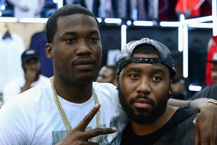 Meek Mill (L) and guest attend the Meek Mill Debut of Dreamchasers x PUMA Collab at New Puma Lab Powered By Foot Locker At Roosevelt Mall In Philadelphia on July 15, 2016 in Philadelphia, Pennsylvania.