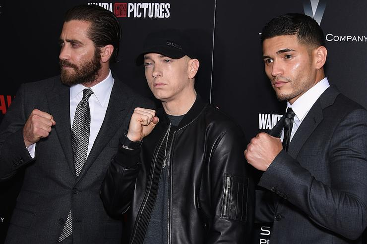 (L-R) Jake Gyllenhaal, Eminem, and Miguel Gomez attend the 'Southpaw' New York Premiere at AMC Loews Lincoln Square on July 20, 2015 in New York City.