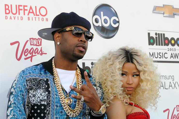 Safaree Samuels (L) and rapper Nicki Minaj arrive at the 2013 Billboard Music Awards at the MGM Grand Garden Arena on May 19, 2013 in Las Vegas, Nevada.