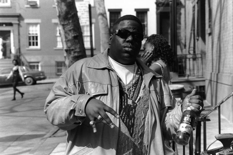 American rapper Biggie Smalls (also known as the Notorious B.I.G., born Christopher Wallace, 1972 - 1997) holds a bottle of St. Ides malt liquor, New York, New York, 1995.