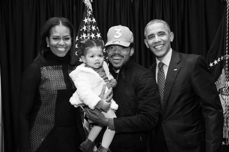 Chance The Rapper poses with his daughter and Michelle and Barack Obama.
