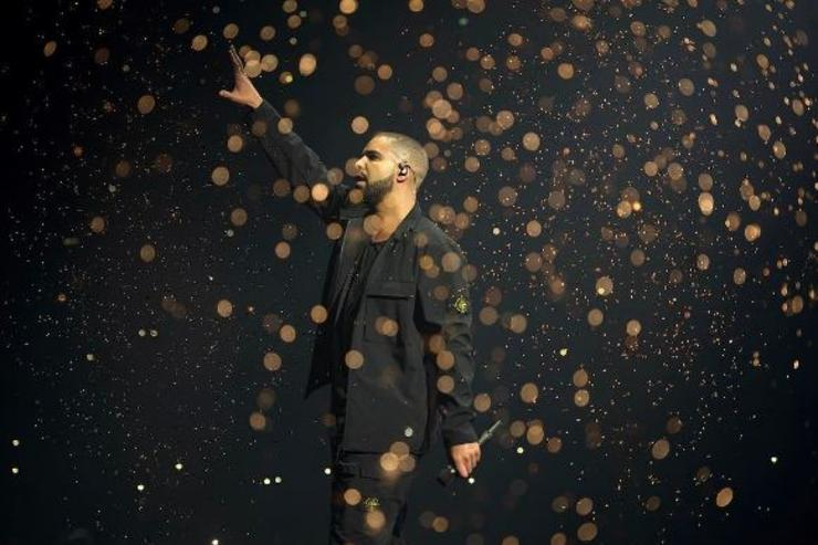 Drake performs onstage in the UK.