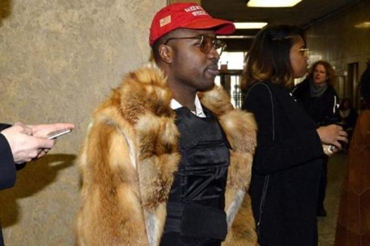 Troy Ave goes to court wearing a bulletproof vest under his fur coat.