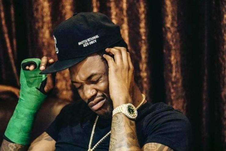 Meek Mill scratches his head.