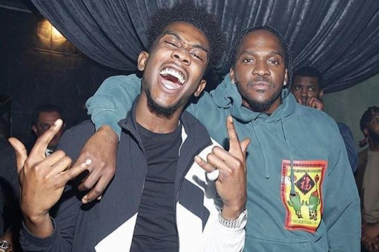 Desiigner and Pusha T pose for a photo.