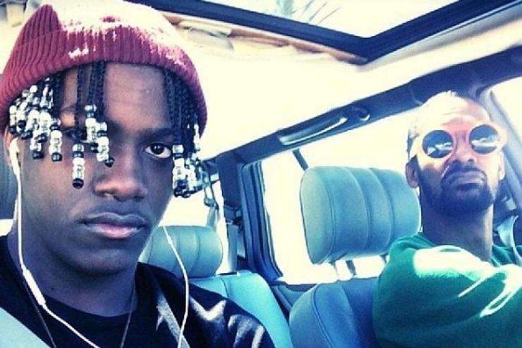 Lil Yachty and his father Shannon McCollum ride in a car.