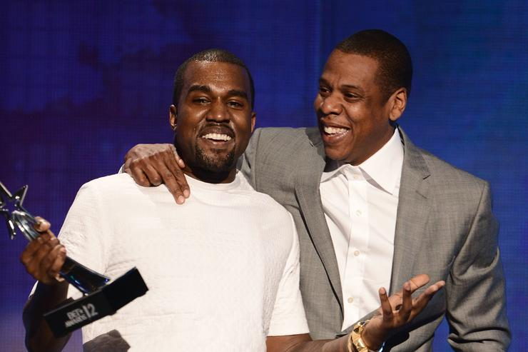 Kanye West (L) and Jay-Z accept the Best Group Award onstage during the 2012 BET Awards